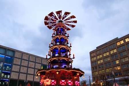 Decorated booths and christmas lights at Alexanderplatz Christmas Market.