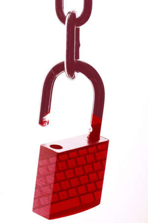 An isolated shot of a red padlock on a chain with a reflection of a keyboard on it -  web security and VPN concept Stock fotó - 154794699