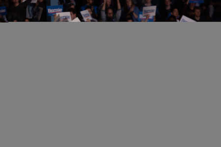 MINNEAPOLIS, UNITED STATES - Nov 03, 2019: A scene from the heated rally of Bernie Sanders with the crowd holding banners actively cheering in Minneapolis, Minnesota