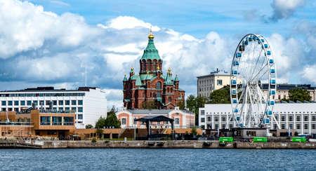 A beautiful shot of the Russian orthodox church and a Ferris wheel in Helsinki, Finland