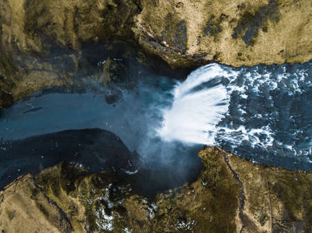 An aerial shot of the high and striking Haifoss waterfall streaming down in Iceland