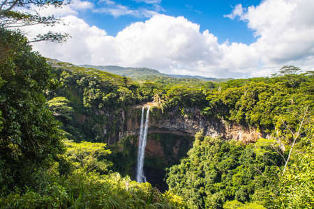 A beautiful scenery of Chamarel Waterfall in Mauritius under a cloudy sky Stockfoto