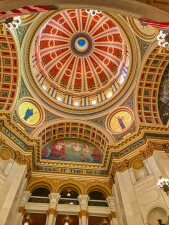 A low angle shot of the beautiful ceiling and walls of Capital Building in Harrisburg, Pennsylvania