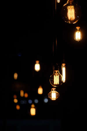 A vertical selective focus shot of streetlights in the middle of the city