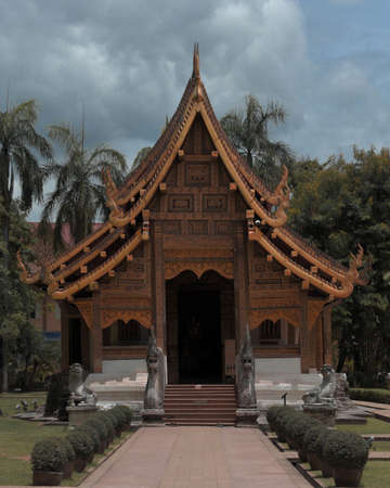 A vertical shot of the famous historic Wat Phra Singh Temple in Thailand