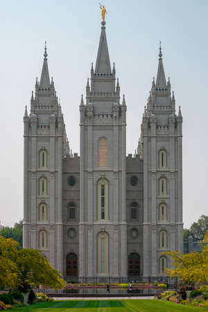 A vertical shot of the historic Salt Lake Temple touching the sky in the USA