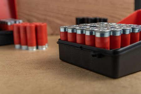 A closeup shot of a full shotgun ammo box on a brown surface