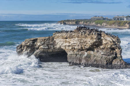 A beautiful view of a big rock in the middle of the sea captured in Santa Cruz, CA, USA