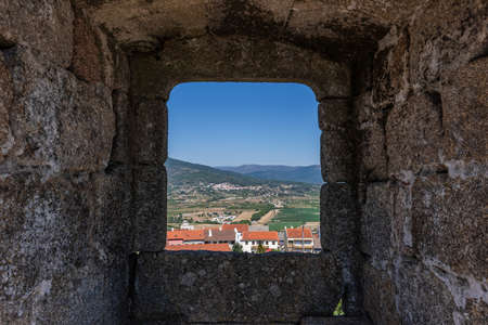 The Castle of Belmonte surrounded by greenery under sunlight in Beiras in Portugal Stock Photo