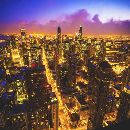 A high angle shot of the city of Chicago from the famous Hancock Tower during nighttime