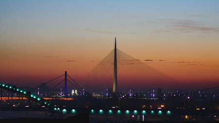 Ada bridge on Sava river at sunset. Modern design and architecture.