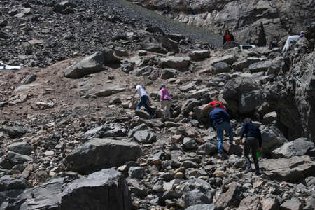 SANTIAGO, CHILE - May 08, 2019: People climbing a rocky mountain