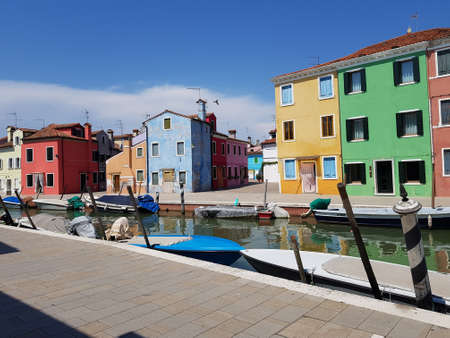 A beautiful shot of different colored houses near the canal in Venice Italy