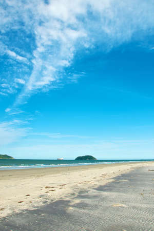 A vertical shot of the breathtaking beach and ocean under the beautiful sky in Ilha do Mel, Brasil
