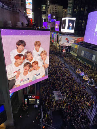NEW YORK, UNITED STATES - Dec 31, 2019: Thousands of people waiting for a Ball Drop in NYC, Times Square. Thousands of NYPD crafts mobilized. Stars incl. Post Malone, BTS, Ryan Seacrest.