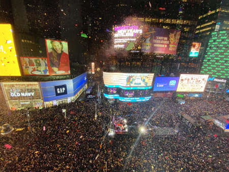 NEW YORK, UNITED STATES - Dec 31, 2019: Thousands of people waiting for a Ball Drop in NYC, Times Square. Thousands of NYPD crafts mobilized. Stars incl. Post Malone, BTS, Ryan Seacrest. Publikacyjne