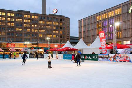 BERLIN, GERMANY - Nov 29, 2019: BERLIN, GERMANY- 29 NOVEMBER, 2019: Rink, Decorated booths and christmas lights at Alexanderplatz Christmas Market.