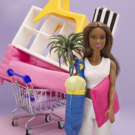 BARCELONA, SPAIN - Dec 20, 2019: A doll has bought much stuff at IKEA and has a huge bag and a cart.
