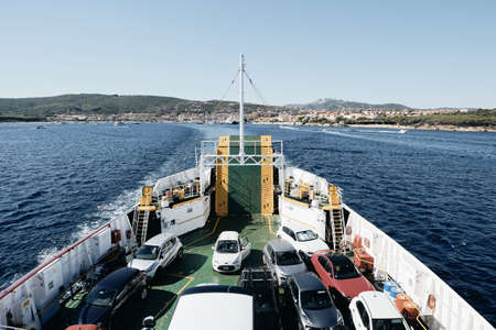 PALAU, ITALY - Aug 20, 2019: Horizontal shot of the view from the upper deck of cars embarked on a ferry boat leaving Palau in Sardinia, Italy