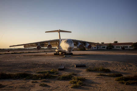 A Derelict Cargo Plane in the desert of the UAE during the sunset