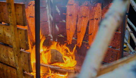 A high angle shot of wood burning in a fire