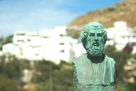 A selective focus shot of the bust of Homer in the Greek island of Ios