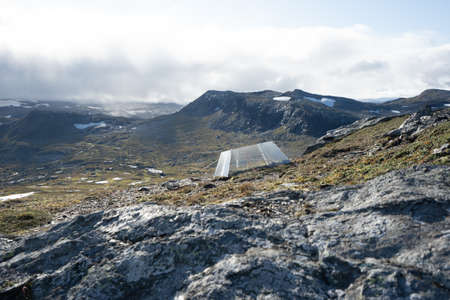 A beautiful landscape with a lot of rock formations and a tent in Finse, Norway Stock fotó