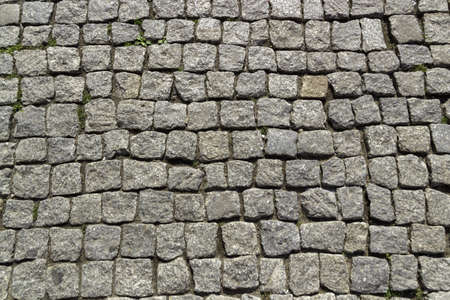 A closeup of a cobblestone road under the sunlight - a nice picture for backgrounds and wallpapers Foto de archivo