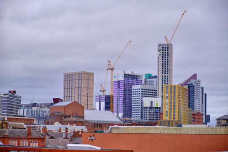 LEEDS, UNITED KINGDOM - Jan 11, 2020: Horizontal shot of leeds skyline on a cloudy day with new tall buildings be constructed and built for new student accommodation Stock Photo