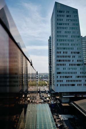 A vertical shot of tall buildings and traffic on streets in Lille, France