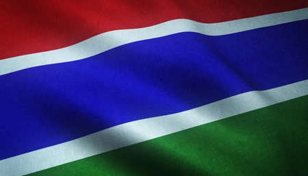 A closeup shot of the waving flag of Gambia with interesting textures