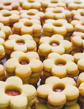 A vertical shot of sweet cookies with jam