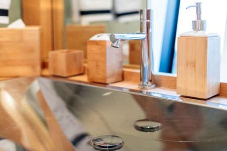 A selective focus shot of a silver faucet Stock fotó