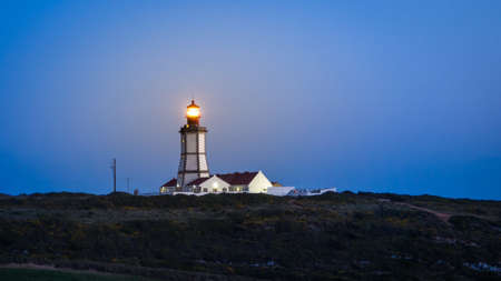 The Lighthouse Cabo Espichel in Sesimbra, Portugal at night time