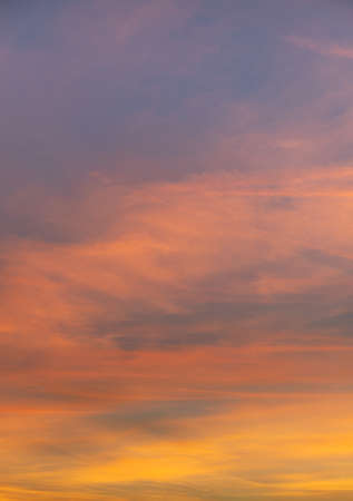 A vertical shot of orange clouds with a scenery of sunrise 版權商用圖片