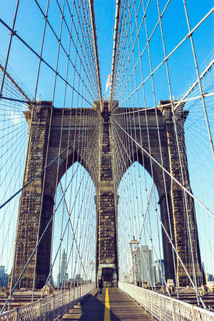 A vertical shot of the famous Brooklyn Bridge during daytime in New York City, USA Stock fotó