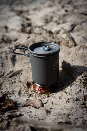 A close up shot of a camping pot set on a tin can Stock fotó