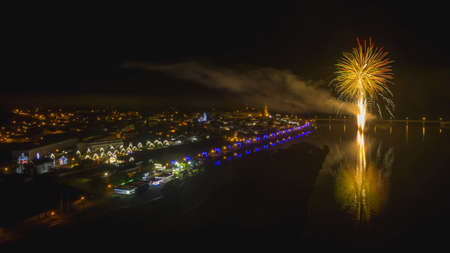 A high angle shot of fireworks near buildings at night time Stock fotó