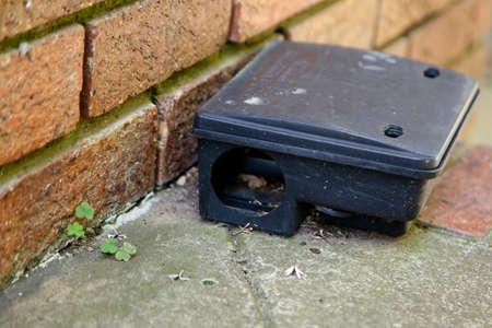 A black plastic rat trap. Pest control concept image. Foto de archivo