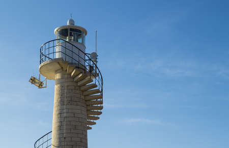 a low angle shot of a lighthouse at Beach Bar Bamboo in Zadar Croatia