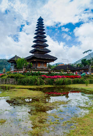 The Pura Ulun Danu Beratan temple surrounded by hills covered in greenery in Bali in Indonesia