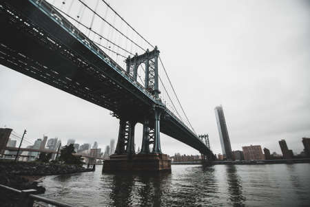 A low angle shot of the Brooklyn Bridge in New York City, USA