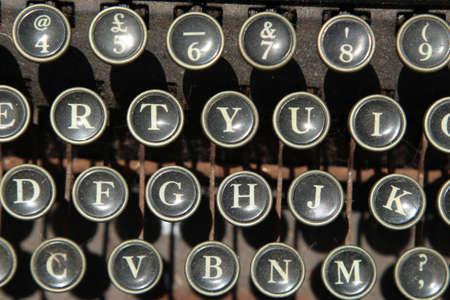 A closeup shot of a vintage typewriter keys