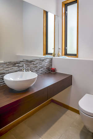 A vertical shot of the modern sink in the bathroom of an apartment Foto de archivo