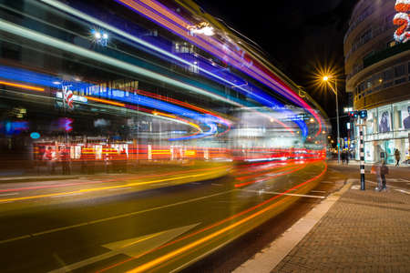 An amazing shot of a street in a modern city with streaks of neon lights Standard-Bild