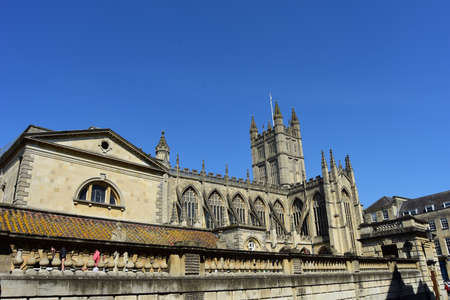 BATH, ENGLAND, UNITED KINGDOM - May 07, 2018: View towards Bath Abbey, Bath, England. May 7 2018. Founded as a monastery in the 7th century, King Edgar was crowned on the site in 973.