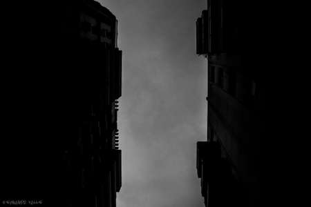 A grayscale low angle shot of two high buildings facing each other in Rio Brazil