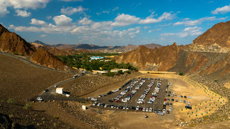 A parking place under a cloudy sky and sunlight in Hatta Dam in Dubai
