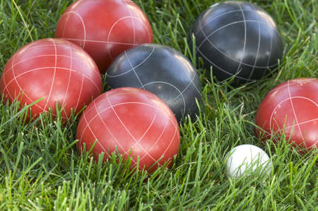 A closeup of colourful bocce balls on the lawn under the sunlight