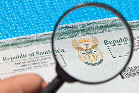 A South African motor vehicle car licence document.  This image has selective focus.
